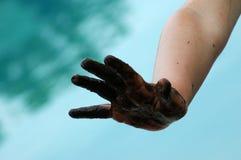Modderige hand Stock Afbeelding