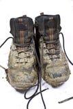 Modderige het lopen van het paar laarzen Royalty-vrije Stock Fotografie