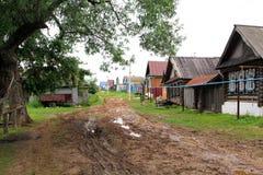 Modderige straat in het dorp Royalty-vrije Stock Fotografie