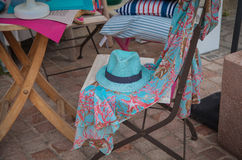 Mode arranement. Mode arrangement with hat and robe on a chair Stock Images