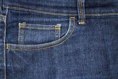Mode av facket av blå grov bomullstvilljeans Arkivfoto