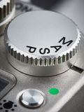 Mode control dial on SLR camera. Closeup vertical Royalty Free Stock Image