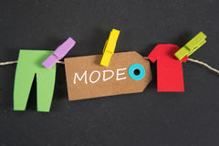 Mode - german for fashion. Mode inscription written on paper tag stock image