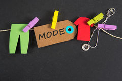 Mode - german for fashion. Mode inscription written on paper tag royalty free stock photography
