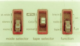 Mode selectors of vintage radio cassette player. Retro style Stock Photography