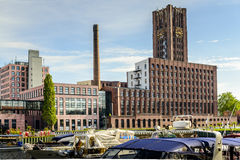 Modecenter Berlin clock tower building  from across the river Royalty Free Stock Image