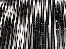 Modedern building facade with bands of twisted metal Stock Image