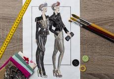 Modedesigne skissar Arkivfoto