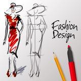 Modedesignen skissar Arkivfoto
