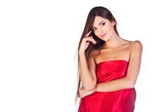Modeflicka i röd klänning Arkivbild