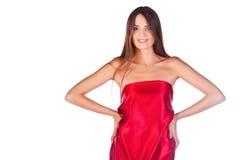 Modeflicka i röd klänning Arkivfoton