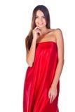 Modeflicka i röd klänning Fotografering för Bildbyråer