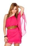 Modeflicka med den rosa klänningen Arkivbild