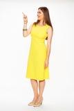 Modefrau im gelben Kleid Stockbilder