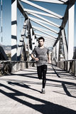 Młodego człowieka bieg z hełmofonami Obraz Royalty Free