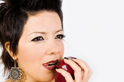 Woman with an apple. Studio photo of Young Women eating a red juicy apple Stock Image