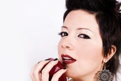 Woman with an apple. Lovely young women eaten a red juicy apple, with a spice of seduction Stock Photo