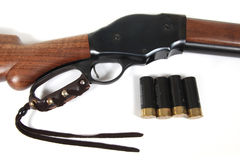 Model 87 Lever Action Shotgun and 12 gauge shells. A model 87 lever action shotgun and 4 12 gauge shotgun shells stock photos