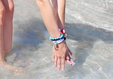 Greek jewelry advertisement on the beach stock images