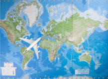 Model aircraft flying over world map Stock Image