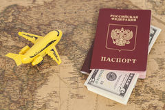 Model aircraft with Russian International passports and dollars Royalty Free Stock Images