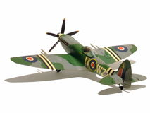 Model Airplane. An assembled and painted model of a Supermarine Spitfire Mk 24 fighter plane - isolated with its shadow over pure white Royalty Free Stock Photos
