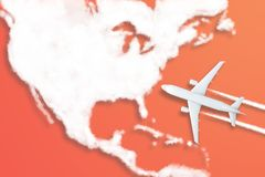 Model airplane design miniature red background fluffy clouds in the shape of continent North America. The idea of tickets for the. Trip, traveling by plane, new stock images