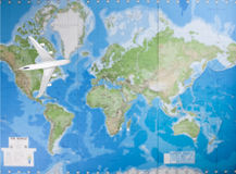 Model airplane flying over world map Royalty Free Stock Photo