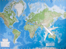 Model airplane flying over world map Stock Photography