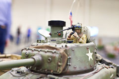 Model American tank M4 Sherman on radio control with tankman. Model of the American tank M4 Sherman on the radio control with a figure of the tankman stock image