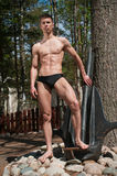 Model with the anchor. Muscled male model posing witht the anchor Royalty Free Stock Photo