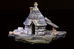 Model of an ancient italian abitation trullo. Tipical of Apulia black background stock photos