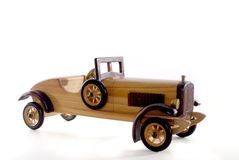 Model Antique Car. Wooden model of an antique car.  isolated on white Stock Photos