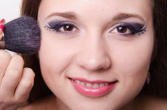 Model is applied to the face powder Stock Image