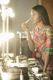 Model Applying Makeup In Dressing Room Royalty Free Stock Images