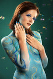 Model in Aqua bodypainting Stock Photography
