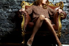 Model in armchair Royalty Free Stock Image