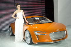 Model on Audi car. GUANGZHOU, CHINA - DEC 27: Fashion Model on Audi car at the 8th China international automobile exhibition on December 27, 2010 in Guangzhou Royalty Free Stock Images
