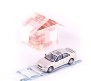 Model auto in het huis van bankbiljetten Stock Fotografie