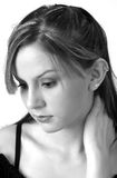 Model in B&W 3. Pretty model in black on white holding neck Royalty Free Stock Photography