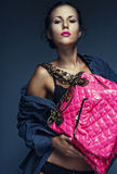 Model with bag. posing in the studio Stock Images