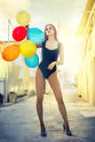 Model with balloons royalty free stock photos