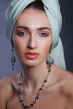 Model with a bandage on head in the Indian style model. Fashion model with a silver jewelry Stock Image