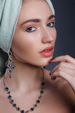 Model with a bandage on head in the Indian style model. Fashion model with a silver jewelry Stock Photos