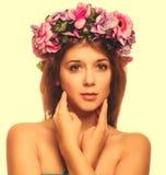 Model beautiful woman face close-up head beauty, wreath of flowe Stock Image