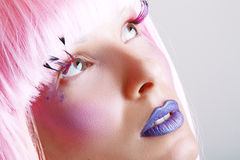Model beautiful women. Gorgeous model beautiful woman with perfect art make up and long false eyelashes made from feathers and pink hair Stock Photos
