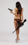 Bikini with guns Royalty Free Stock Image
