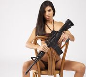 Bikini with guns Stock Photos