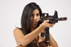 Bikini with guns Royalty Free Stock Photo