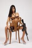Bikini with guns Royalty Free Stock Image